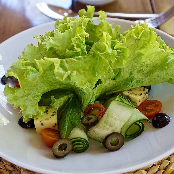 Mixed salad with cucumber, cherry tomatoes, olives, herb cheese