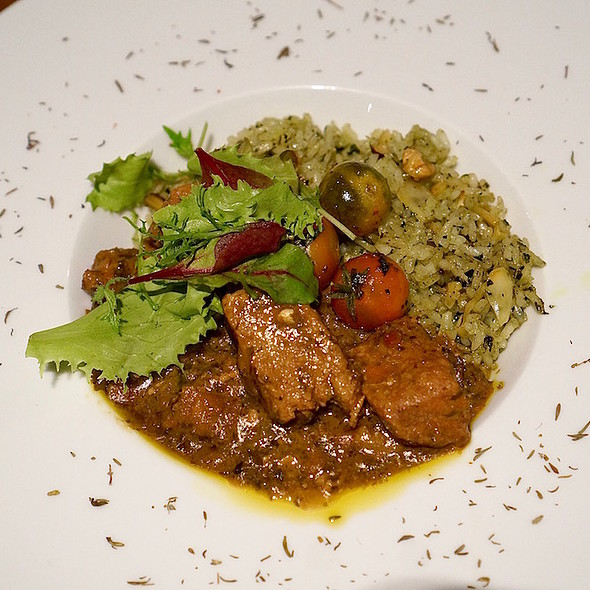 Chilean wild boar stew, green rice and nuts