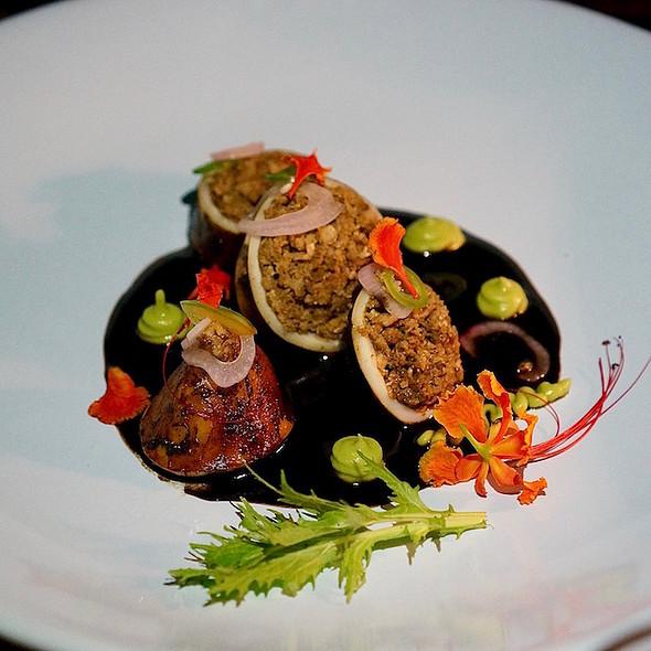 Squid chiparón, Longaniza sausage, recado negro sauce, avocado mousse, cured onions