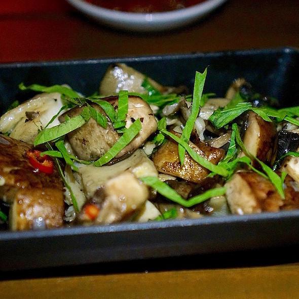 Wok fried assorted mushrooms, epazote, Thai red chili