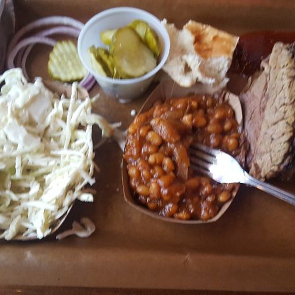 Brisket dinner with baked beans and coleslaw