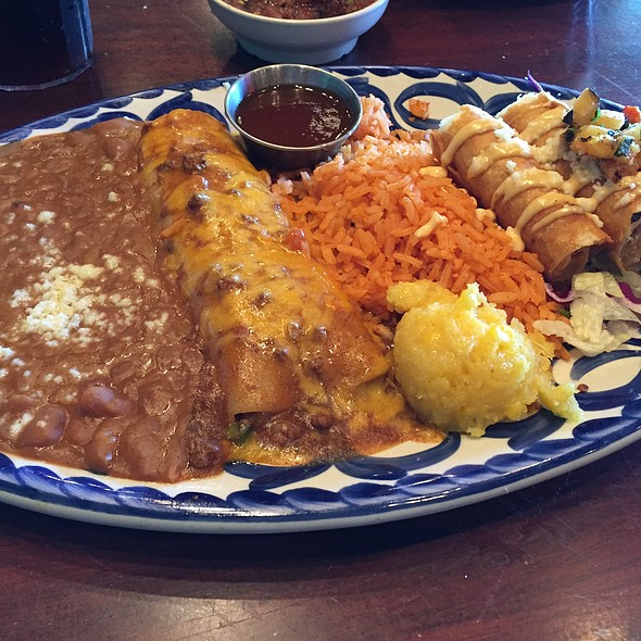 Beef Enchilada and Crispy Chicken Flautas with Refried Beans and Spanish Rice