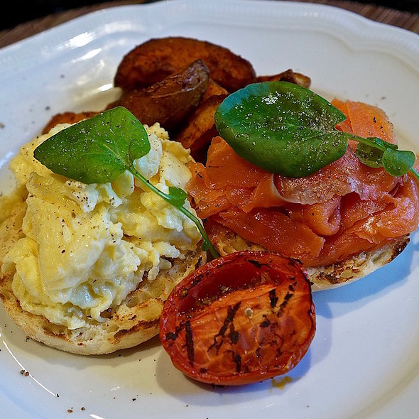 House-smoked salmon, scrambled eggs, English muffin, grilled tomato, potato wedges