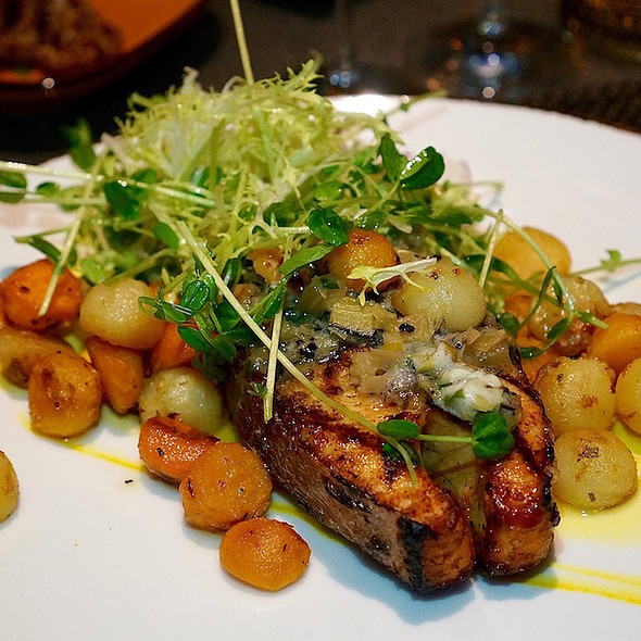 Grilled Kuterra salmon steak, charred leek and fennel butter, roasted root vegetable pearls