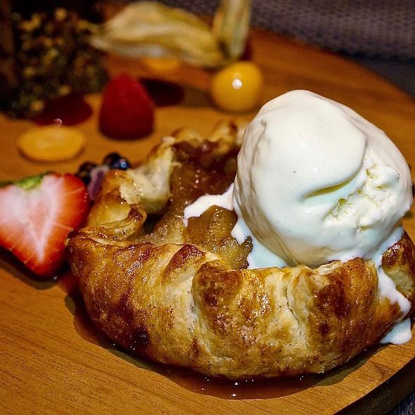 Warm apple pie, cinnamon spiced Okanagan apples, Fairmont Vancouver Airport honey ice cream, rosemary caramel sauce