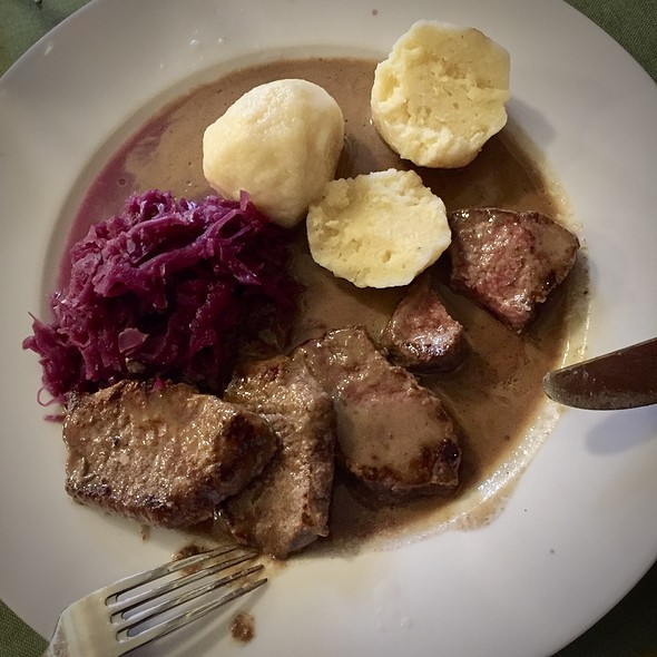Prime cuts of a wild boar back with potatoe dumplings and red cabbage