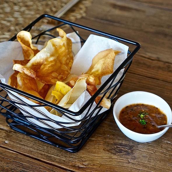 Plantain and cassava chips, tomato salsa