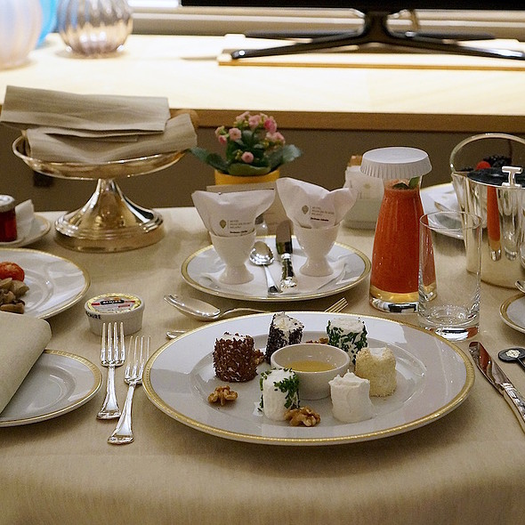 Breakfast in bed –soft-boiled eggs, grilled cherry tomatoes, mushrooms, bread basket, wild berries, ginseng coffee, goat cheese platter