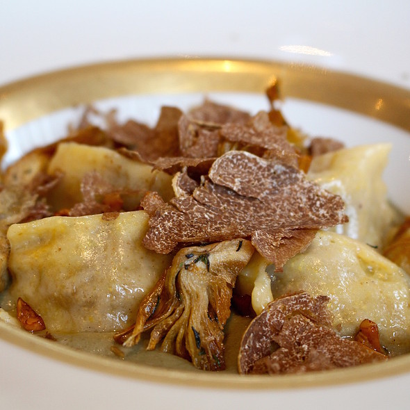 Ravioli of polenta filled with 'salsiccia' (Italian sausage) and chanterelles, artichoke cream and white truffle