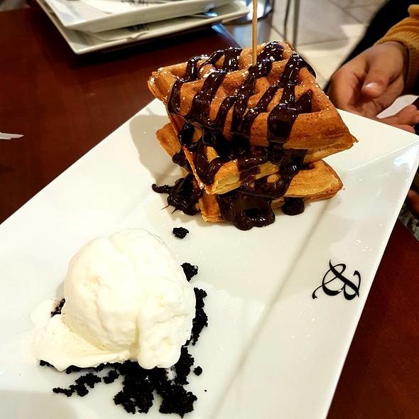 Belgian Waffle with Vanilla Ice Cream and Chocolate Sauce
