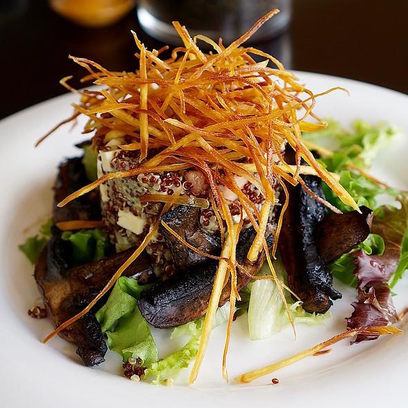Quinoa salad, grilled portobello mushrooms, feta cheese, cucumber, cherry tomato, avocado, lettuce