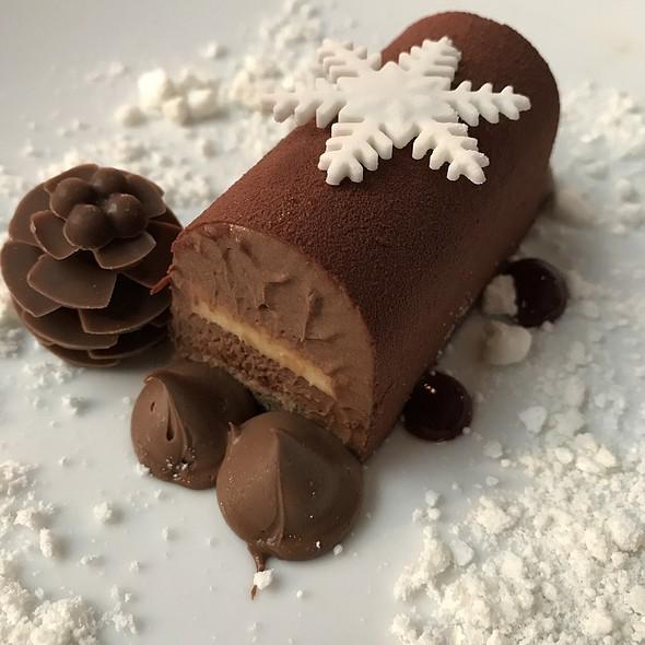 Chocolate and Hazelnut Log Cake with Raspberry Compote