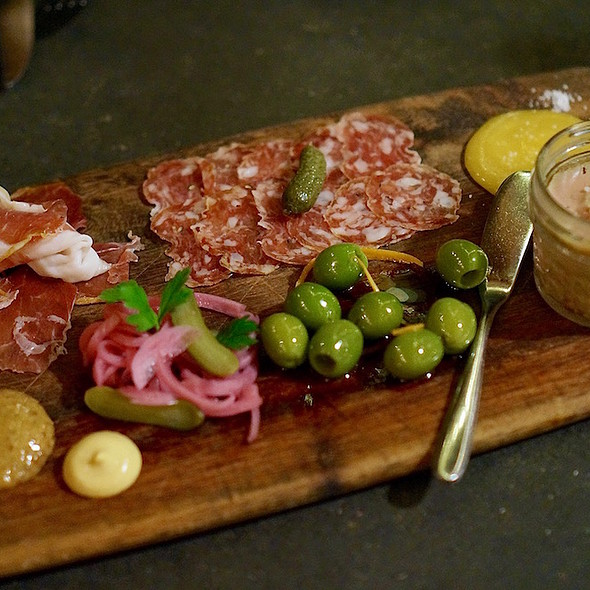 Charctuerie board – chicken liver mousse, gentile salami, prosciutto, castelvetrano olives, crusty baguette, raw honey, pickled vegetables