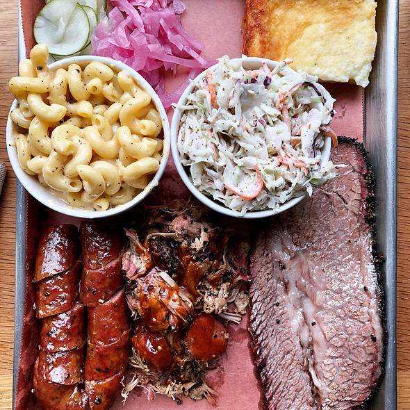 Lone Star Platter with Moist Texas Brisket, Pulled Pork BBQ, Hanzo Sausage, Mac-N-Cheese, Cole Slaw, and Custard Corncake