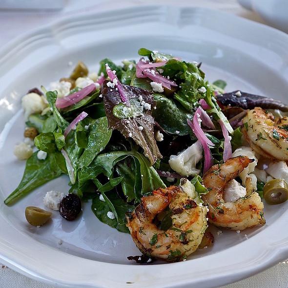 Herb roasted shrimp, garden greens, feta cheese, green olive, cauliflower, golden raisin, pickled onion, white balsamic vinaigrette