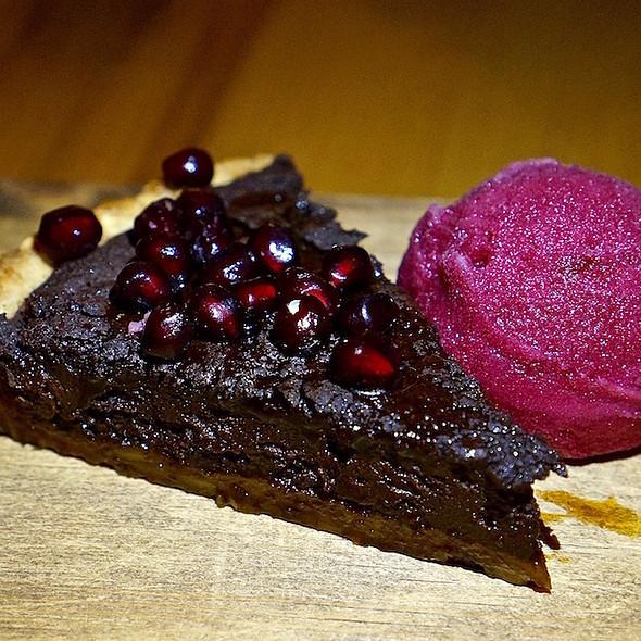 Valrhona dark chocolate pomegranate tart, pomegranate sorbet