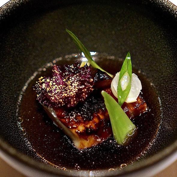 Caramelized sablefish, toasted kale, scallion, pork belly, bouillon Japonais