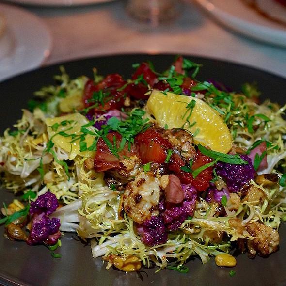 Frisée salad, pickled and roasted cauliflower, blood orange, navel orange, pistachios, citrus vinaigrette