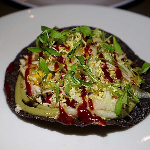 Smoked rainbow trout tostada, blue corn tortilla, avocado purée, cabbage, corn