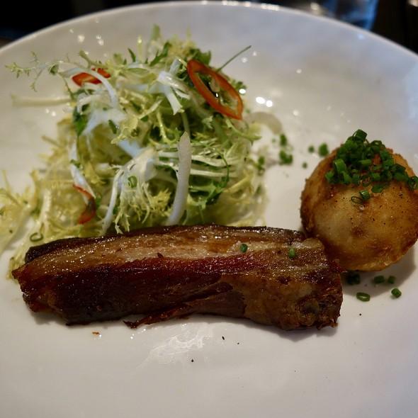 Smoked Tennessee Pork Belly with Crispy Farm Egg, Frisée Lettuce and Truffle Lemon Vinaigrette