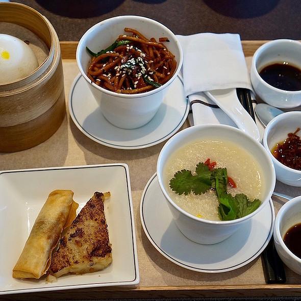 Chinese Breakfast – black mushroom spring roll, turnip cake, ha gau, siu mai, custard bun, sweet corn congee with Hokkaido scallops, wolfberries, fried egg noodles, Chinese sausage, fish cake, XO sauce, soy sauce, Worcestershire sauce