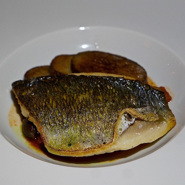 Seared wild bass, tomato sage fondue