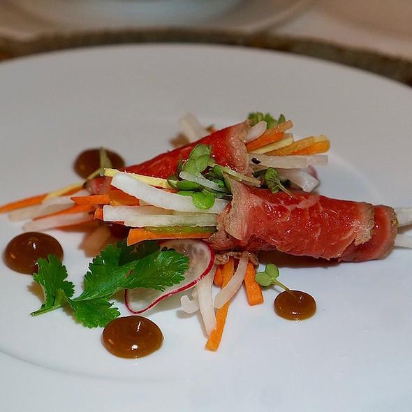 Vietnamese beef sirloin wrap, julienned vegetables, Asian vinaigrette