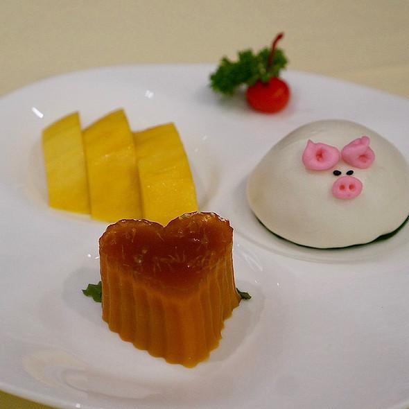 Mango, steamed red date cake, egg custard bun