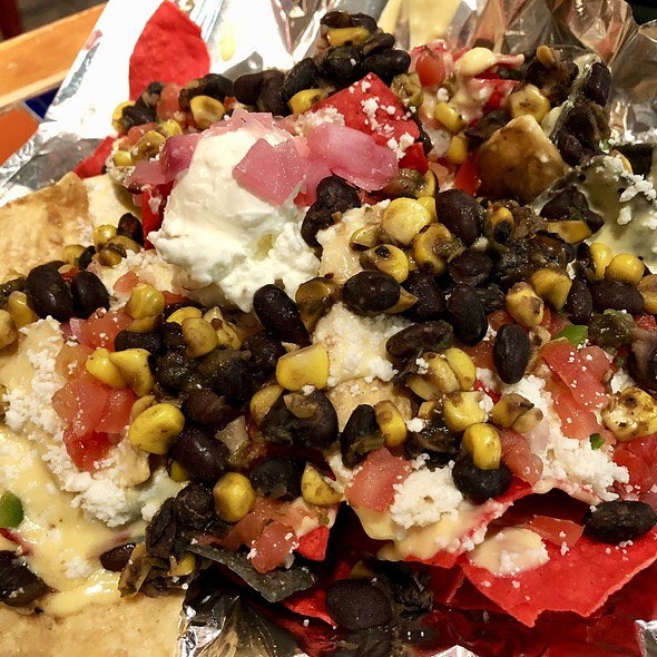 Nacho Chips with Black Beans, Roasted Corn, and Pickled Onions