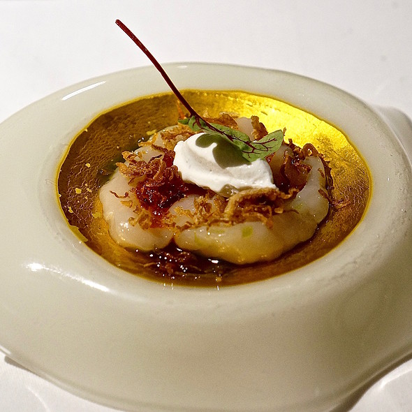 Scallop, uncooked curry, fried onion, coconut ice cream, chili oil, curry oil