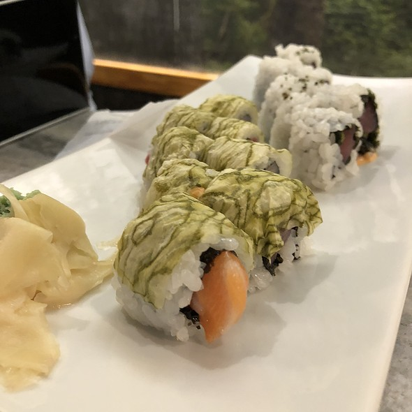 Kamikaze Roll with Hamachi, Tuna, Salmon, Spicy Mayonnaise, White Seaweed, and Eel Sauce