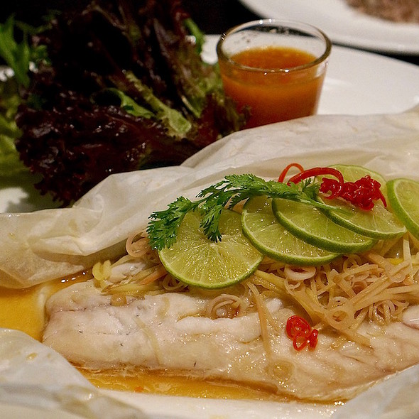 Steamed sea bass in parchment paper with chili and lime