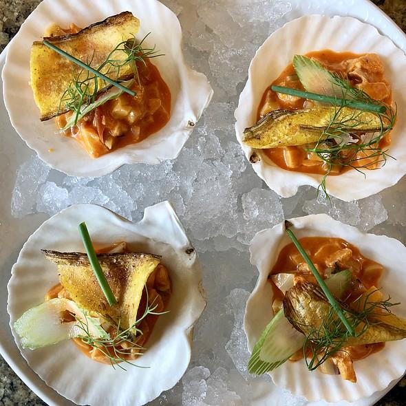 Ceviche Mixto del Dia with Aji Amarillo, Key Lime, Yucca Chip, and DIll