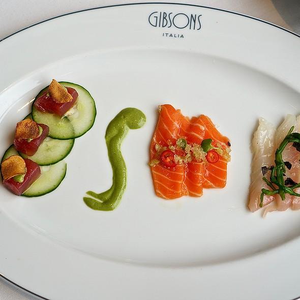 Crudo trio – bigeye tuna w/ crispy sunchoke; ora king salmon w/ red finger lime; wild striped bass w/ sea beans and black lava salt