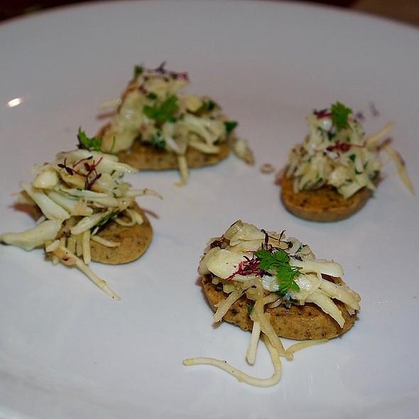 Crab toast, marinated crab salad, apple-celery root slaw, Oregon black truffle
