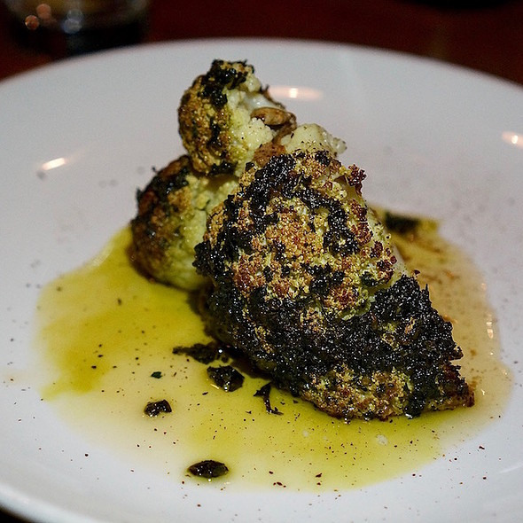 Whole roasted cauliflower, herb rub, truffled brown butter