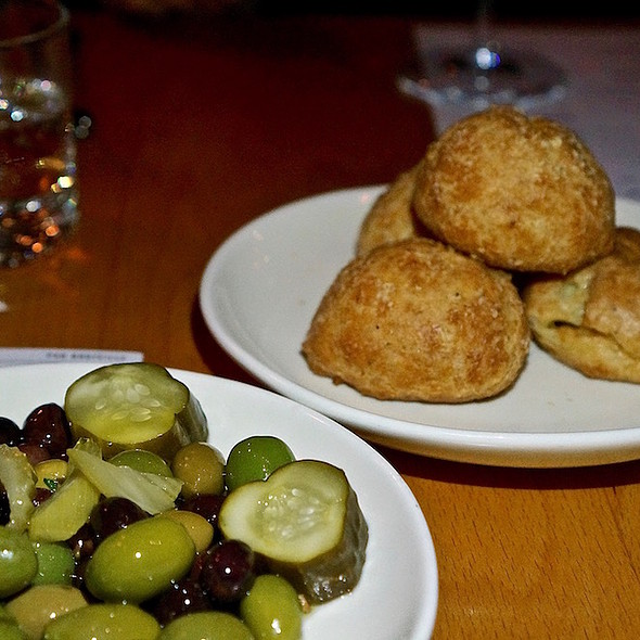 Black pepper gougères, marinated olives, Grandma Agnes' pickles