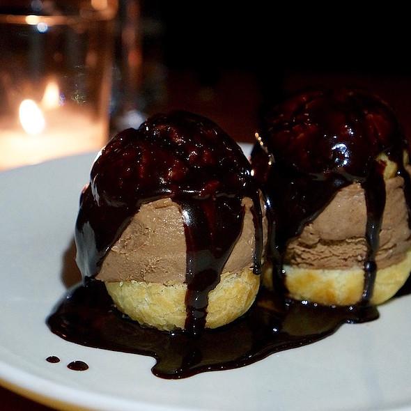Profiteroles, malted chocolate semifreddo, fudge sauce