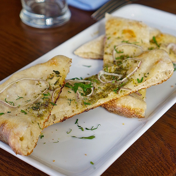 Housemade flatbread, olive oil, shallots, savory herbs @ Headwaters
