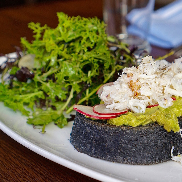 Avocado toast, dungeness crab, charcoal sourdough, tomato, radish, smashed avocado, sea salt