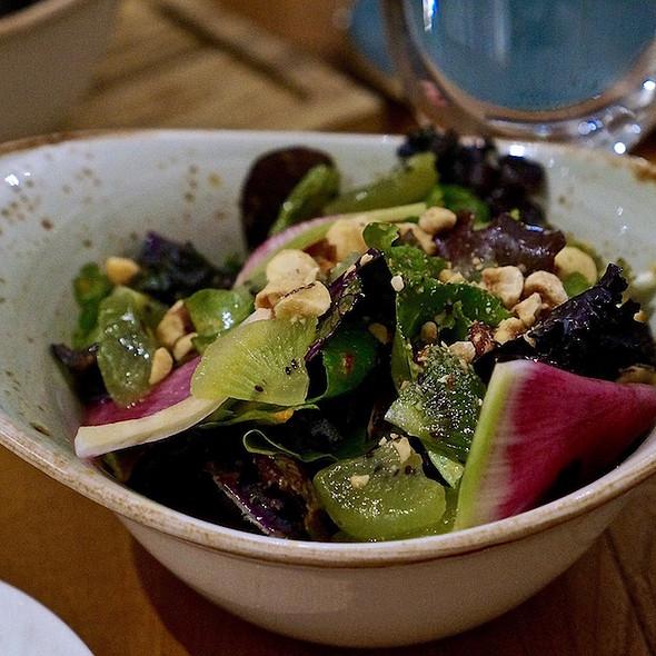 Mixed green salad –seasonal greens, cilantro, mint, hazelnuts, kiwi, lime vin