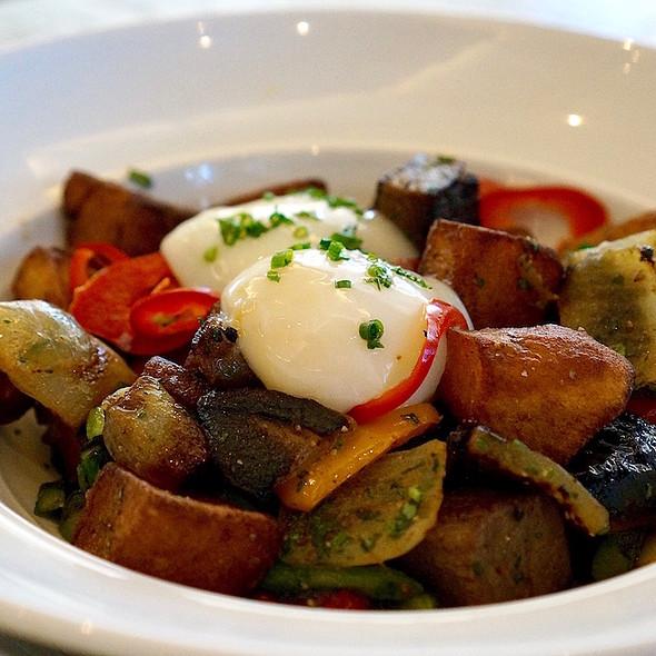 Brisket hash skillet – braised smoked brisket, potatoes, roasted peppers, sweet onions, poached eggs