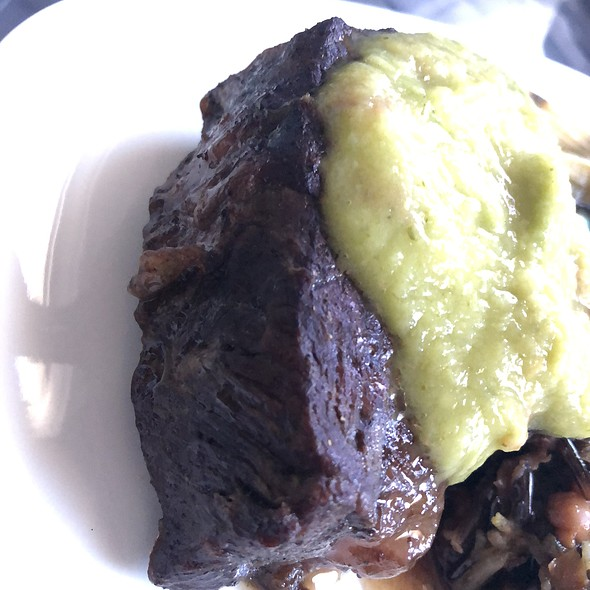 Braised Flatiron Steak with Wild Rice and Black-Eyed Pea Pilaf, Scalliona, Avocado, and Pickled Chili