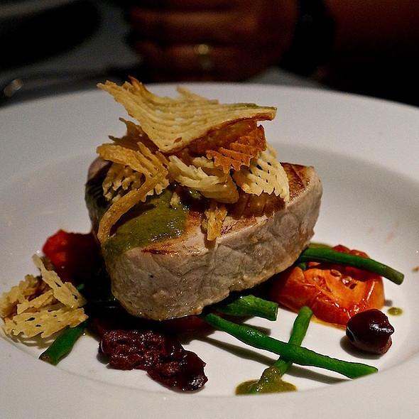 Grilled yellowfin tuna, tomatoes, snake beans, kalamata olives, salsa verde