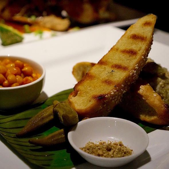 Middle Eastern vegetable platter – smoked eggplant dip, dukkah, pickled okra, tomato garlic chickpeas, grilled Turkish bread