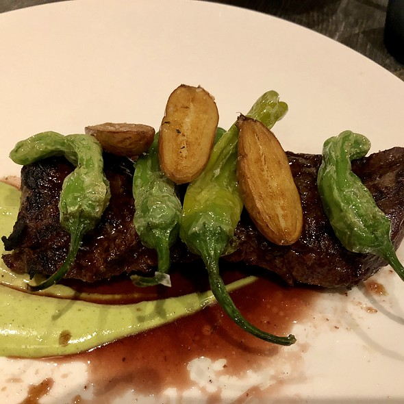 Grilled Marinated Prime Skirt Steak Roasted with Fingerling Potatoes, Shishito Peppers, Chimichurri, and Caramelized Onion Jus