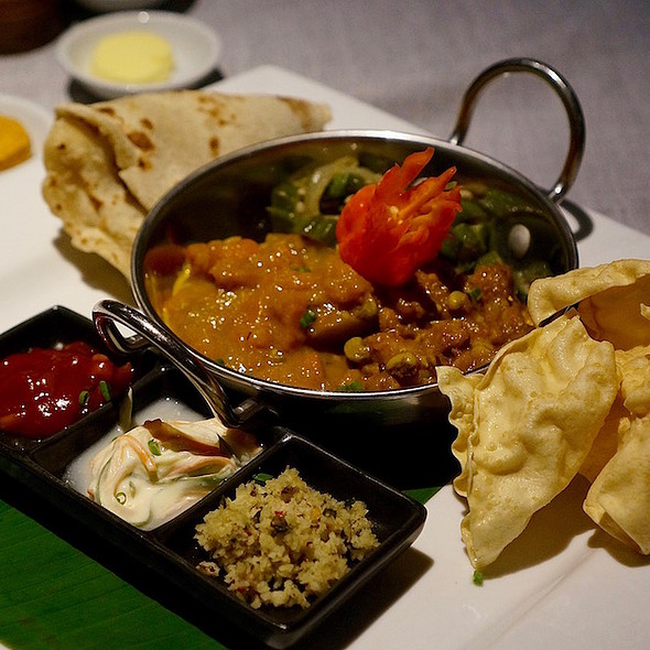 Mixed local vegetable curries, roti, pappadum, cucumber raita, coconut and tomato chutneys