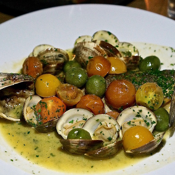 Branzino acqua pazza, clams, cherry tomatoes, olives