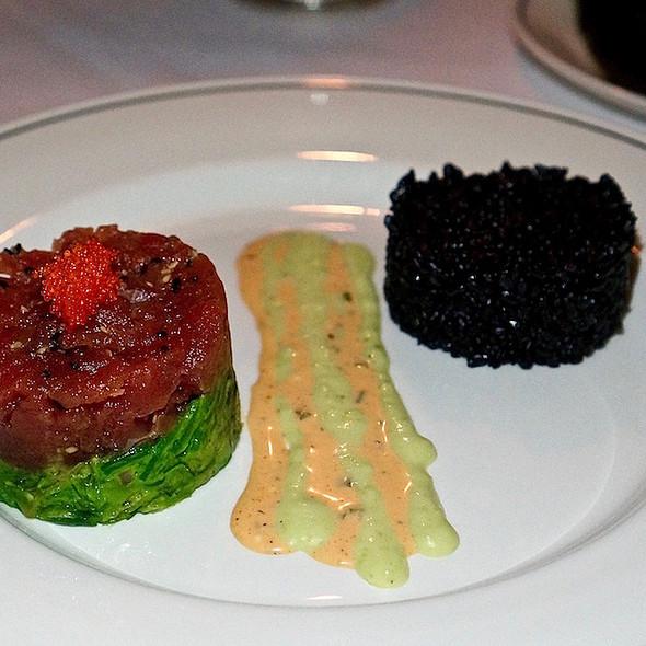 Tuna tartare tower, sushi-grade tuna, avocado, seaweed salad, forbidden black rice, dynamite sauce, nori
