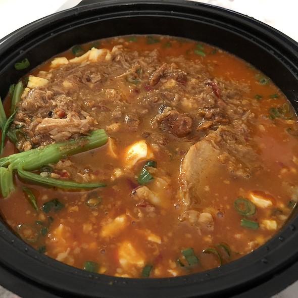 Spicy Red Chili Ramen With Dashi-Chicken Broth, Smashed Egg, Minced Pork, Scallions, And Rye Noodles @ Ivan Ramen Slurp Shop